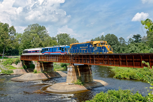 The surprise of the day was NECR 3850 on the point of the FRA Geometry Train, seen here crossing the bridge at Three Rivers MA.<br /> 8/7/2018