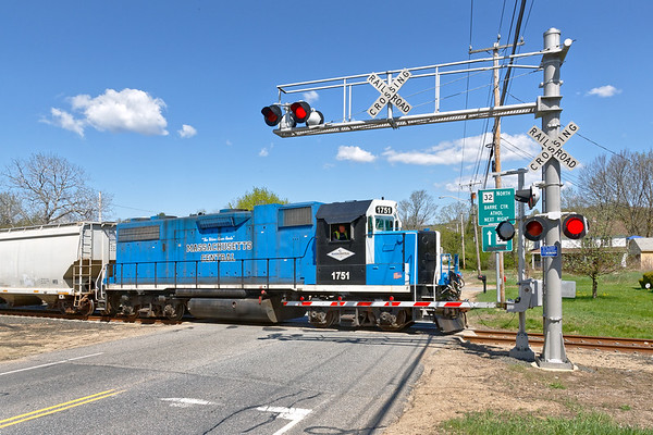 Mass Central 1751 crossing Rte 32 on it's way to the mill complex in South Barre.<br /> 5/9/2018