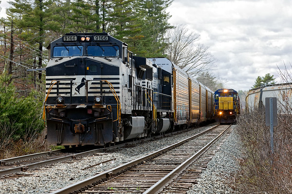 At Wagon Wheel, EDPO squeezes between the auto racks of 28N and grain cars on the loop track at the milling.<br /> 4/26/2018