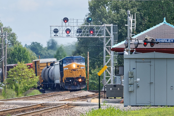 """Train ED-9 notches up under the new signal bridge and past the """"T"""" station in Shirley MA.<br /> 8/20/2018"""