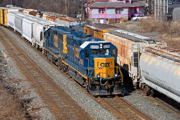 As NECR eases down the yard lead, train B740 takes the controlled siding into the CSX yard at Palmer MA.<br /> 3/6/2018