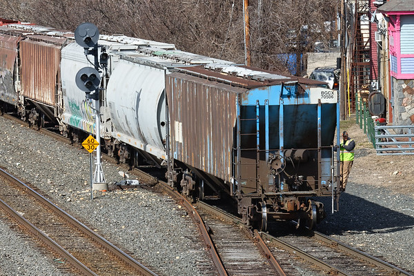 With a long cut of cars for CSX, NECR backs down the yard lead into the yard at Palmer MA. 3/6/2018