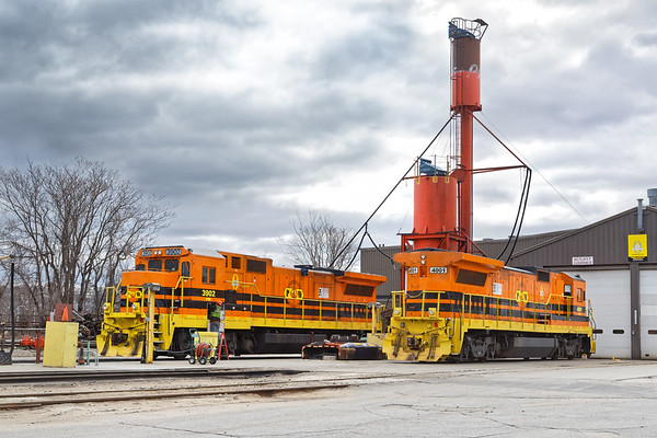 Looking quite snazzy in their G&W liveries, B39-8 P&W 3902 and B40-8 P&W 4001 sit quietly under the sand tower at the P&W engine house in Worcester MA.<br /> 4/18/2018