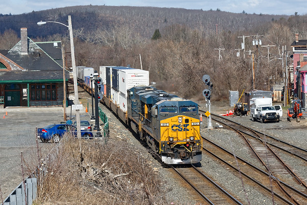 In Palmer MA, CSX train Q012 splits the signals at MP83 as the crew installing new signals waits on the sidelines.<br /> 4/5/2018