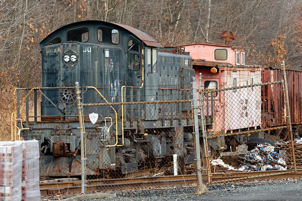 The Central of New England has quite a collection of equipment at their yard in Scantic CT including a couple of cabooses, a couple of critters and three RS-1's, all of which look like they haven't moved in quite some time.<br /> 12/6/2018