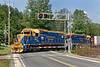 Led by two blue and gold New England Central GP38s, train 608 heads south across the Hospital Crossing in Palmer MA.<br /> 7/5/2018