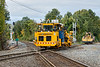 After all the CSX traffic had cleared, a surfacing crew crossed the diamond and worked down through the NECR yard.<br /> 10/12/2018
