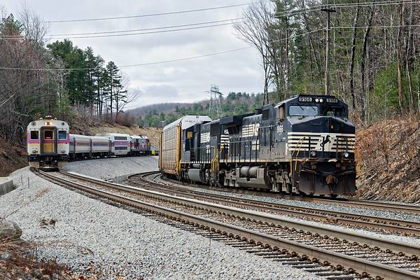 "After recrewing in Gardner, train 28N pauses at Wachusett as an inbound ""T"" commuter train heads out of the station.<br /> 4/26/2018"