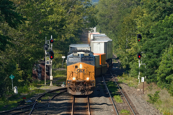 On a hot steamy summer morning, train Q012 crosses over from main to main at MP64 in East Brookfield MA. The track to the right used to be the main but it's used now for servicing the auto transfer facility and the EBSR.<br /> 8/2/2018