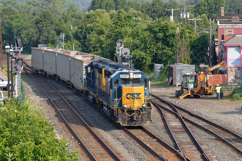 Train B740 eases into the CSX yard at MP83 in Palmer MA as work continues on the new signal installation.<br /> 7/17/2018