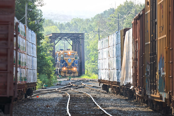 In the early morning haze, NECR 3845 pauses at the iron bridge at the far south end of their yard in Palmer MA.<br /> 8/27/2018