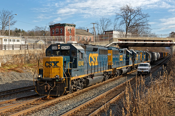 With a couple of track cars holding the main at MP83 in Palmer MA, train B740 pulls out of the yard with 4 units and 53 cars for Springfield.<br /> 12/5/2018