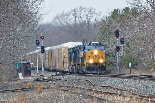 Featuring 4 units pulling 120 auto racks for the EBSR, train Q264 eases onto the siding at MP64 in East Brookfield MA.<br /> 4/17/2018