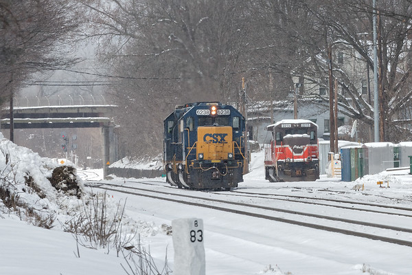 Another taste of winter...<br /> Under still more snow flurries at Palmer MA, B740 light power holds the siding and P&W (G&W) 2215 waits to be delivered to the CSOR.<br /> 3/9/2018