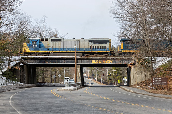 Train POSE eases out of the south end of the Hill yard on it's way to Worcester.<br /> 3/23/2018