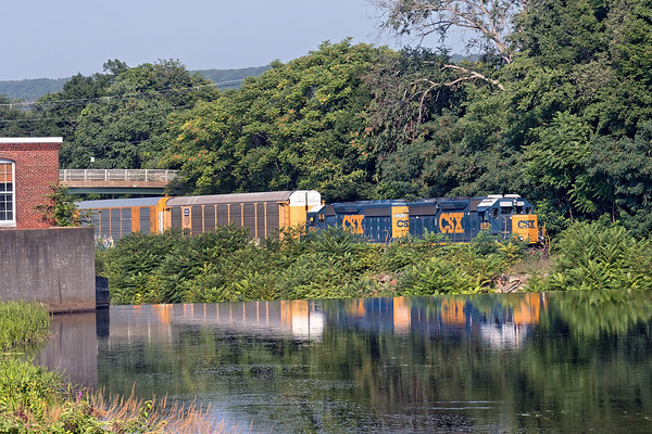 Following 012 east, B740 heads passes the old Wright's mill complex in West Warren with three auto racks for the EBSR in East Brookfield.<br /> 8/7/2018