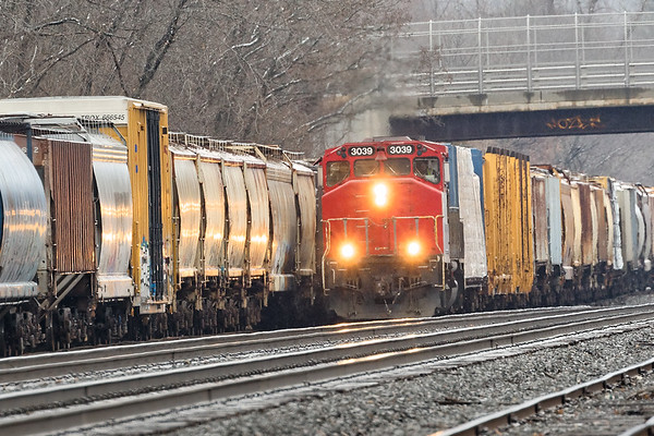 NECR 3039 pulls a long cut of cars out of the far east end of the CSX yard at MP83 in Palmer MA. 2/23/2018