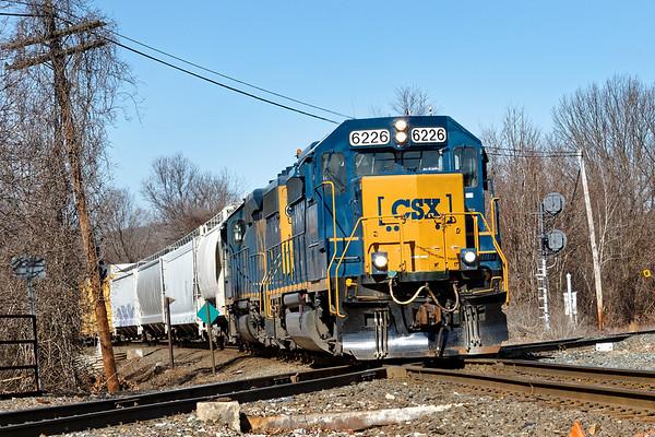 CSX train B740, the Springfield Local, slams across the CSX/NECR diamond at MP83 in Palmer MA.<br /> 3/6/2018