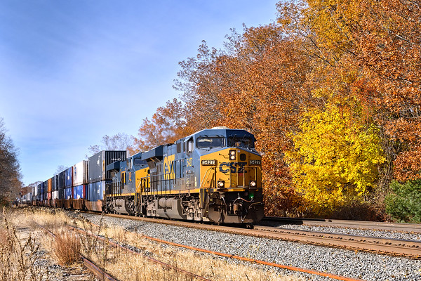So far this Fall the color has been a real dud here in central New England.<br /> One exception is this late color at MP64 in East Brookfield with stack train Q022 heading toward Worcester in the foreground.<br /> 11/4/2018