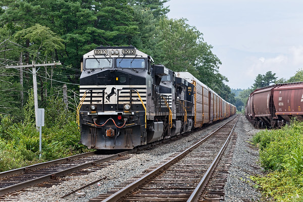 Train 28N waits to back into the auto facility at the Willows as the second half of the grain train works the loop track at the milling.<br /> 8/20/2018