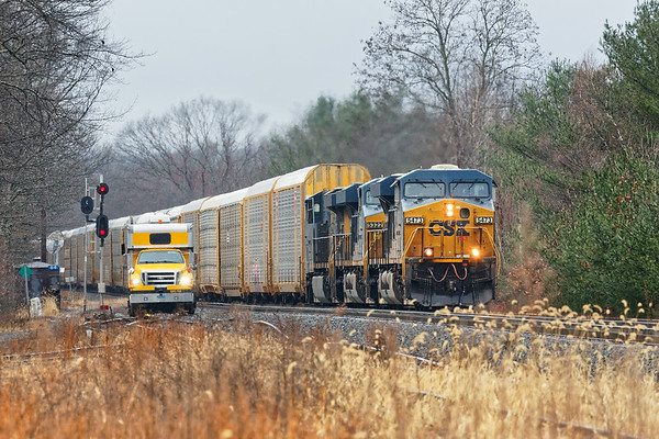 With a Sperry truck watching from the East Brookfield yard lead, next up was Q264 with a long drag of auto racks for the EBSR.<br /> 11/27/2018
