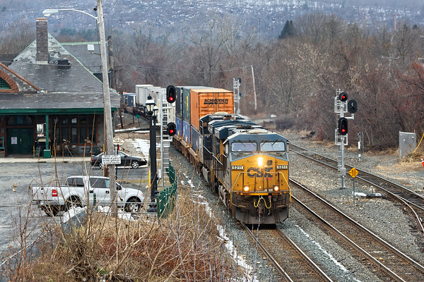Train Q022 eases past the historic depot and into the CSX yard at MP83 in Palmer MA.<br /> 11/21/2018