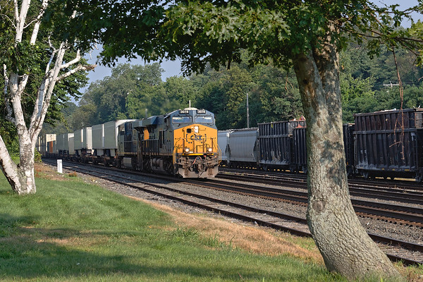 At MP83 in Palmer MA, a relatively short Q012 rolls towards the early morning light with 100 axles for Worcester.<br /> 8/7/2018