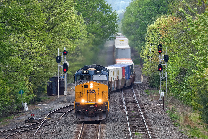 CSX train Q020 runs main to main at MP64 where the single track goes to double. The other track is the controlled siding where the EB&S handles auto racks at the trans load facility.<br /> 5/20/2018