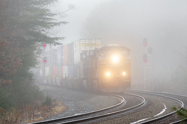 Train Q022 cuts its way through pea soup fog in the S-curves at MP60 in Spencer MA.<br /> 11/26/2018