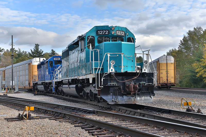 EBSR 1272 and leased unit CEFX 3184 tackling the switching duties at the auto facility in Spencer MA. In the past, they have used the CSX power that comes in on Q264 for switching but today they happened to be using their own power.<br /> 10/22/2018