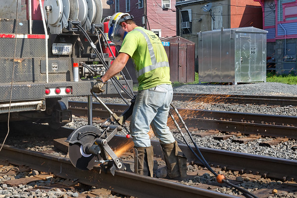 At MP83 in Palmer MA, a CSX crew replaces a section of rail on the main.<br /> Hot work on a hot day...<br /> 7/30/2018