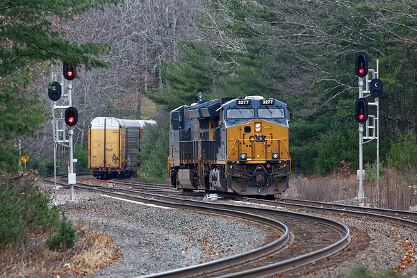 After Q012 goes by, Q264 light power crosses over from the siding to the main to run around it's train and tie the power down at MP64.<br /> 11/15/2018