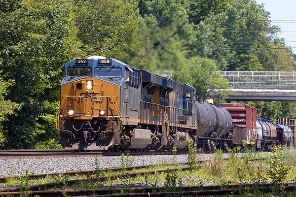 As soon as 022 cleared, the signals went green for a westbound, Q427, which had an interesting train starting with a number of coil cars and a long string of ethanol cans on the rear.<br /> 7/10/2018