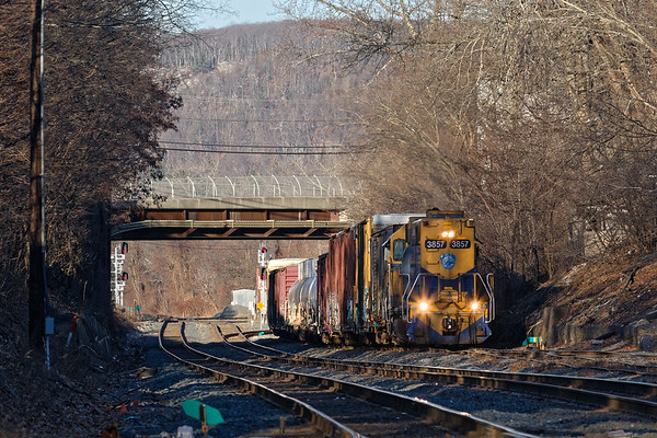 Surrounded by long Winter shadows, NECR 3857 works the CSX yard lead at MP83 in Palmer MA.<br /> 12/27/2018