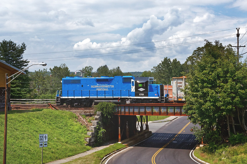 Against a background of building clouds, MCER 1751 crosses over Main St in Ware MA on it's way back to the yard in Palmer.<br /> 8/10/2018