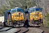 While Q264 light power holds the siding at MP60, train Q022 rolls past at track speed on the main with containers for Worcester. It's a sure sign that winter may be relaxing it's hold when long lens/heat wave distortion begins to show up again!<br /> 2/28/2017