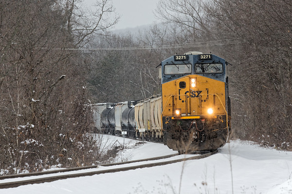 As 2021 was switching in Palmer, CSX train Q426 was stopped just past the diamond, waiting for them to clear.<br /> 3//9/2018
