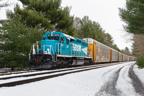 On an otherwise quiet Sunday morning on the railroad, EBSR 1272 pulls a long string of auto racks off the controlled siding in Spencer MA.<br /> 11/18/2018