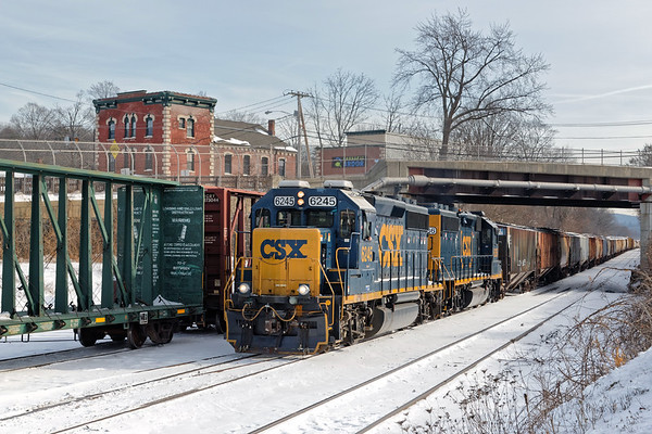 Happy New Year! Our record cold spell has finally given way to more normal winter weather and with new snow on the ground, it's time to venture back out to the railroads. My first stop is MP83 in Palmer MA where train B740 was just heading back to Springfield with a long string of cars.<br /> 1/8/2018