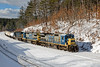 """Train BFPO passes the new Wachusett """"T"""" station with a long drag of slurry and liquefied petroleum gas cars sporting 1075 placards. 1/9/2018"""