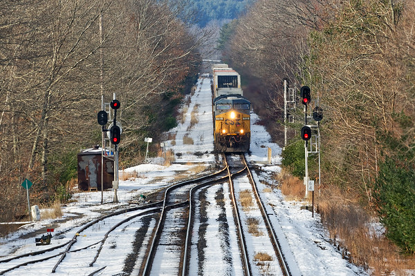 Train Q012 approaches MP64 in East Brookfield MA.<br /> 11/21/2018