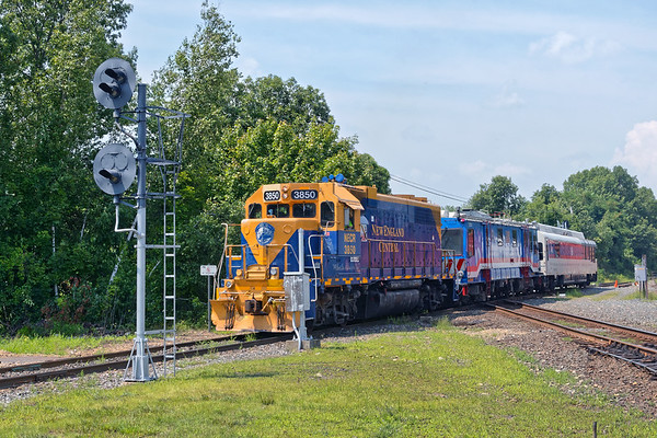 The NECR Geometry Train crosses the diamond at MP83 in Palmer MA.<br /> 8/7/2018