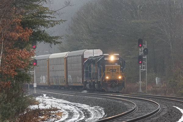 On a dark, foggy morning, in a fairly unusual move, train B740, the Springfield local, hits the signals at MP60 in Spencer MA with 9 auto racks for the EBSR. 1/22/2018