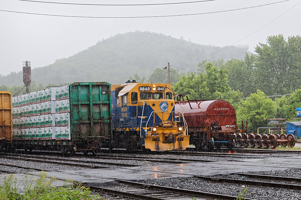 A few hours in the rain in Palmer MA...<br /> Coming up from the south was NECR train 608 with three yellow and blue units.<br /> 6/4/2018