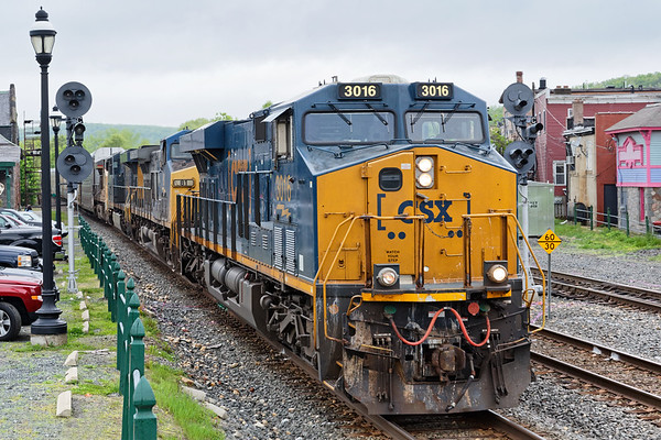 Next through was Q264 with 4 units and a long drag of auto racks for the East Brookfield & Spencer.<br /> 5/20/2018