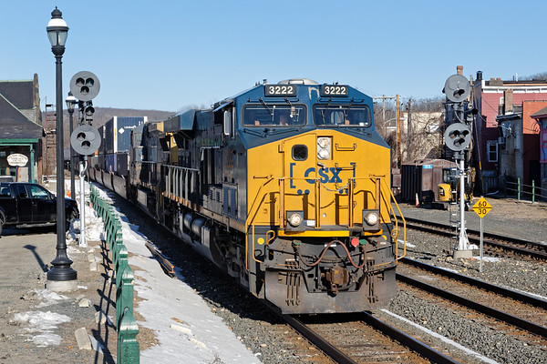 Running at close to track speed on the main, CSX train Q012 splits the signals at MP83 in Palmer MA.<br /> 3/18/2018