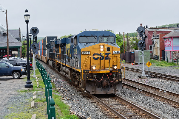 On a dark, overcast morning, train Q010 splits the signals at MP83 in Palmer MA.<br /> 5/20/2018