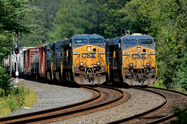 With Q264 light power holding the siding at MP60, train Q436 rolls through at track speed on the main with three units and a long train.<br /> 9/3/2018