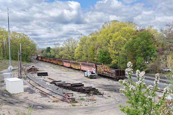 CSX tie train on the siding at MP64, East Brookfield MA.<br /> 5/15/2019