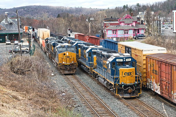 Plugged in Palmer.<br /> Q022, the stack train bound for Worcester, takes the main as B740 light power holds the controlled siding and NECR  handles a cut of cars on the yard lead.<br /> 4/15/2019